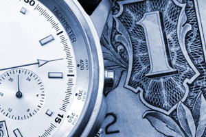 Photo of watch and dollar bill