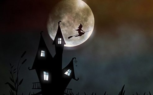 Cartoon image of a witch flying on a broomstick