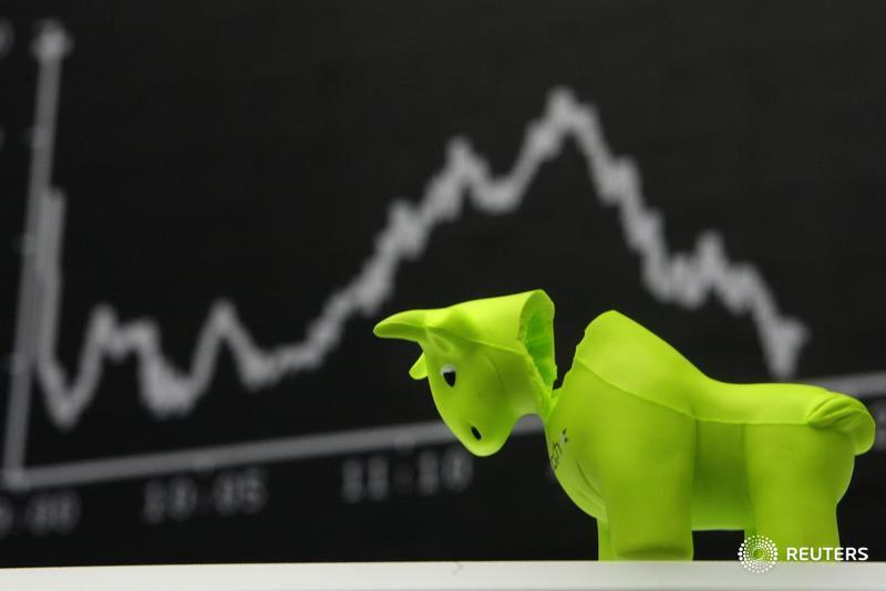 A bull styrofoam figure is pictured in front of the DAX board at the Frankfurt stock exchange September 16, 2008. Photography: Alex Grimm