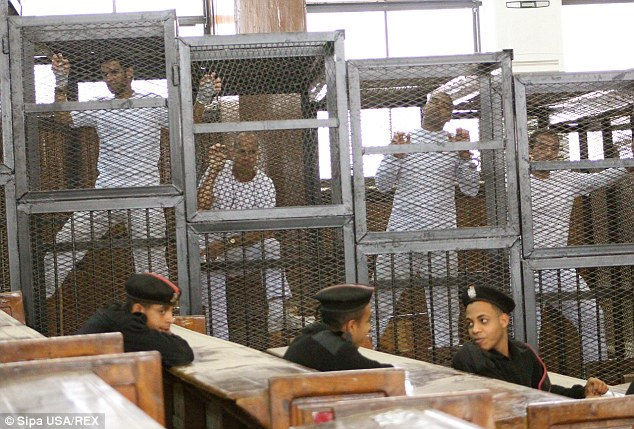 Journalists appear in cages for Egyptian trial