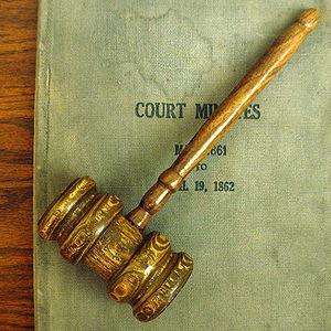 Old gavel and court minutes displayed at the M...