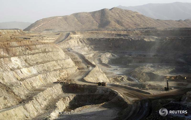 Trucks ferry excavated gold, copper and zinc ore from the main mining pit at the Bisha Mining Share Company (BMSC) in Eritrea, operated by Canadian company Nevsun Resources. Photography: Thomas Mukoy