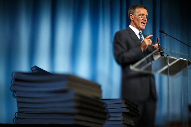 Ken Wainstein presents his October 2014 report on academic issues with UNC student-athletes.  Image by Jerry Wolford, courtesy of the News & Record.