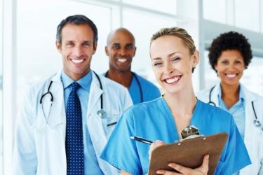 Happy medical team of doctors together